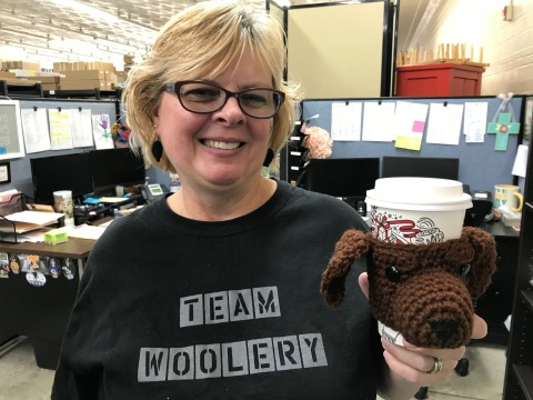 Debbie with her crochet dog cup cozy